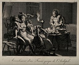 A_seated_Greek_woman_on_an_obstetrical_stool_being_held_in_p_Wellcome_V0014911